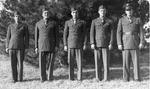 Five men in military uniforms by Louis C. Aicher 1887-1977