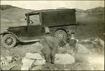 009_04: Two Men Lifting a Specimen by George Fryer Sternberg 1883-1969