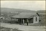 017_03: Two Men in Front of a Log Cabin by George Fryer Sternberg 1883-1969