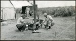 017_04: Cooking a Meal in a Camp Stove by George Fryer Sternberg 1883-1969