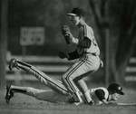Baseball Player Sliding into Base and Catching Baseball