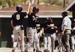 Fort Hays State University Baseball Players Clasping Hands in Air