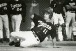 Fort Hays State University Baseball Player Sliding into Base