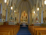 Nave and sanctuary of the St. Catherine Catholic Church by Patty Nicholas