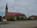 St. Joseph Catholic Church and the rectory by Patty Nicholas